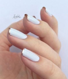 White with gold tip manicure.