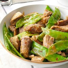 """Pork 'n' Pea Pod Stir-Fry Recipe -A spicy citrus sauce coats tender strips of pork and crisp snow peas in this speedy stir-fry from Jane Shapton of Irvine, California. """"We like this dish extra spicy, so I use a tablespoon of red pepper flakes,"""" Jane notes. Wok Recipes, Stir Fry Recipes, Asian Recipes, Cooking Recipes, Healthy Recipes, Chinese Recipes, Pork Ham, Fried Pork"""