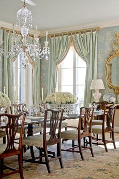 Trying not to hyperventilate over the light blue Gracie deliciousness that is Janet Simon's dining room in her historic central New Jersey brick Georgian revival. Regency style gold mirror, silk taffeta drapes, antique chairs, and baskets of hydrangeas - just gorgeous.