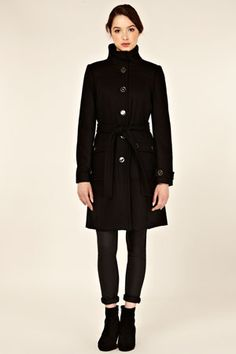 This funnel neck coat has buttons to fasten down the front and a tie belt to cinch in the waist.