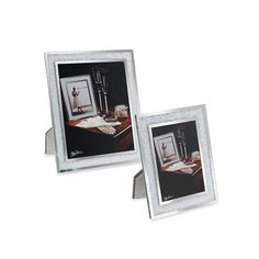 Beautiful memories surrounded by sparkling crystal. Oleg Cassini brings his impeccable taste and fashion sense to this glistening crystal picture frame to showcase your special moments. Coordinating gift items also available.