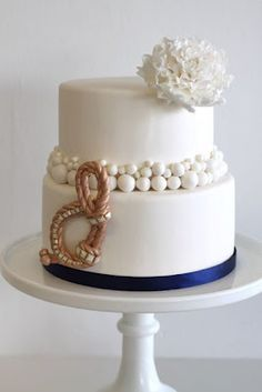 What a darling cake. The knot (already tied) is such a nice touch!
