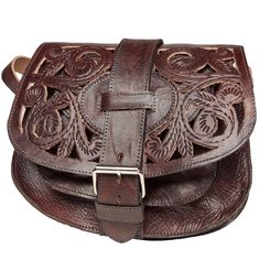Add flair to your wardrobe with a Moroccan Cut Leather Saddle Bag, which features a distinctive cut-out design and adjustable strap for versatility as a shoulder or crossbody bag. This bag is handcrafted of rich chocolate brown Moroccan cowhide leather.