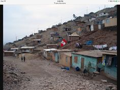 Slums outside of Lima, Peru.  They are on land taken over by mostly rural…
