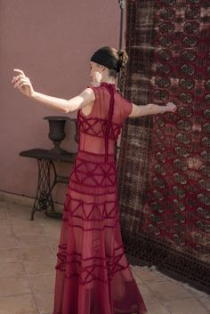 Floor length burgundy high neck sleeveless dress with pom-pom applique Inspired by Moroccan architectural motives city of Marrakech. The deep burgundy color takes from the shadows of the red walls surrounding the city of Marrakech. Fastens at the back with zip and three delicate buttons on the neck. Constructed from see-thru tulle, partly double layered for added comfort. Effortlessly standing out, elegant, sexy and ultra-feminine. #viktoriavarga #viktoriavargabudapest #designer… Deep Burgundy, Burgundy Color, Tulle Poms, Ball Skirt, Red Walls, Applique Dress, Signature Collection, Marrakech, Moroccan