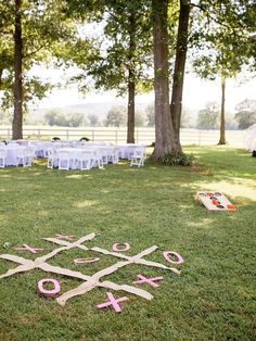 It wouldn't be a true barbeque without some lawn fun! Arrange life-sized games like jenga or tic-tac-toe as a playful wedding reception idea that'll to keep your guests in a lively spirit.