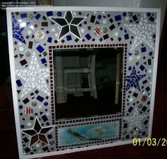 """24"""" x 24"""" mosaiced stained glass mirror. This took me about 3 weeks to finish. I would definitely do a few things differently but was satisfied with the finished results"""