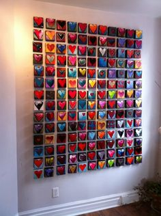 """Create a """"wall of hearts"""" for the victims of domestic violence, each member paints a small canvas..."""