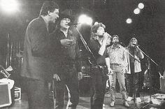 "1989. Poco joined Richard Marx onstage at a private party/Roxy gig on Hollywood's Sunset Strip. The sextet performed an a cappella version of Sam Cooke's ""Bring It on Home to Me."" Pictured left to right: Rusty Young, Jim Messina, Richard Marx, Richie Furay, George Grantham and Randy Meisner. What a pity that there's no audio or video recording. How fabulous it must be! 😲"