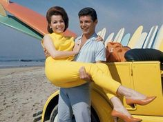 Annette Funicello and Frankie Avalon on Malibu Beach during filming of 'Beach Party', California, 1963