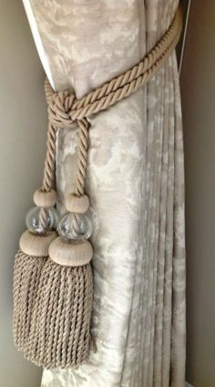 www.suefosterinteriors.co.uk.  Beautiful Zoffany curtains with beaded tiebacks