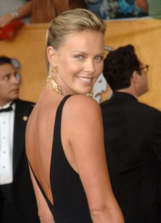 In January 2006, Charlize Theron hit the red carpet at the SAG Awards in a backless black gown.