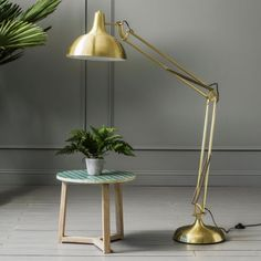 Our oversized brass angle floor lamp has a classic angular shape and a metallic brass finish. With a gold shimmer, this lamp is a subtle statement piece. Angle over your favourite living room reading seat or home office desk for some stylish illumination. Merci Boutique, Farmhouse Floor Lamps, Merci Paris, Unique Floor Lamps, Living Etc, Brass Floor Lamp, Metal Floor, Living Room Lighting, Kitchen Lighting