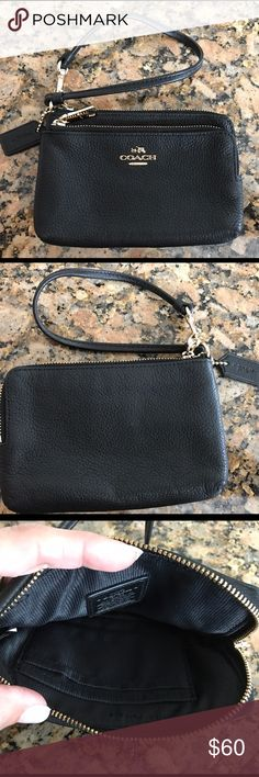 Coach Black Leather Double Zipper Wristlet Beautiful, like new, black pebbled leather double zipper  wristlet.  Gold tone shiny zipper, no scratches on zipper pull. Smoke free, pet free home. No odors, stains or damages. Excellent condition, NO SIGNS OF WEAR! Coach Bags Clutches & Wristlets