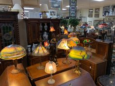 We just got in this amazing collection of antique reverse painted and slag glass lamps. We even have two double and triple signed Handle Lamps! come in and escape the heat at Gannons Antiques Vendor Displays, Glass Lamps, Cool Lamps, Antique Art, Home Goods, Handle, Indoor, Antiques, Amazing