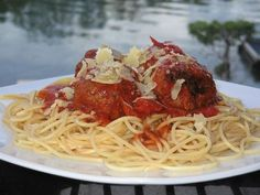 This is Lidia Bastianichs recipe for spaghetti and meatballs. She is a chef on tv who makes very authentic italian food.  This recipe is the next best thing to being in New York City in Little Italy.
