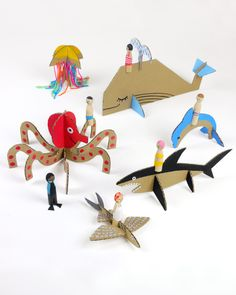 "These easy-to-make cardboard creations are the perfect answer to every kid's go-to saying, ""I'm bored."" They pick the creature, you help cut out shapes and bring them to life. And when paired with peg dolls, you make a whole undersea world."