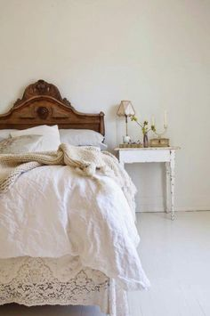Love the simplicity of this bedroom with the contrast of wood on white