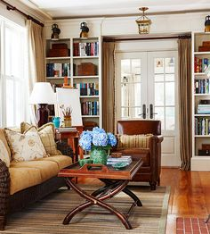 Door framed with bookcases; note overhead area as well, with window treatment on sides in alcove created by built-ins.