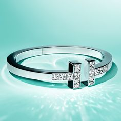 Give her a gift she'll love almost as much as she loves you. Tiffany T square bracelet in 18k white gold with diamonds.
