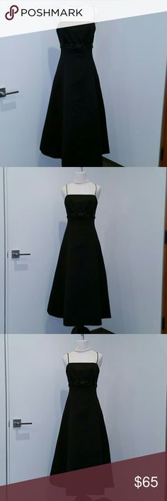 David's Bridal Classic Black Dress David's Bridal Classic Black Dress Bridesmaid dress It has not been altered. It is in perfect condition.  Worn only once, and then professionally dry cleaned. Built-in black satin and tulle petticoat.  Size 10 David's Bridal Dresses Wedding