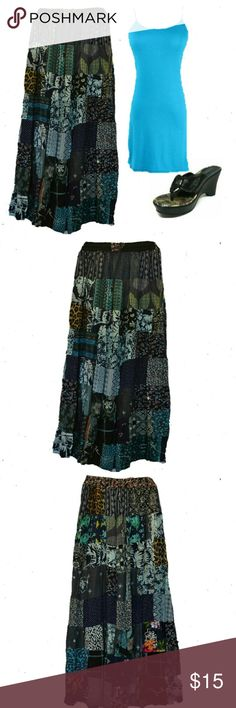 """Boho Gypsy Maxi Skirt Handmade in Jaipur India. Vegetable dye material sewn together. Boho gypsy skirt with varied print panels sewn together. Rayon/Cotton Blend. Light  thickness material. Can also be worn as a dress. Gathered elastic waistband.  Primary colors blue, teal, black.  NWT  Flat lay measure L 38 """" Hip 20"""" (40"""" circumference)  Elastic stretched waist band W 32-36"""" BohoBeauRoseBoutique Skirts Maxi"""
