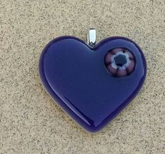 Check out this item in my Etsy shop https://www.etsy.com/listing/451363388/purple-fused-glass-jewelry-pendant