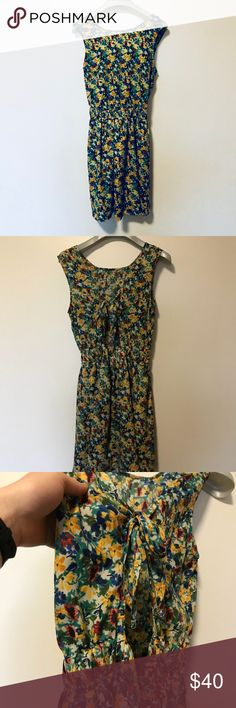 Floral Open Back American Apparel Dress One of my favorite pieces. Great, used condition. Like new. High neck line in front and open back with bow. Floral print, red, yellow, and green. Size: XS/S American Apparel Dresses Mini