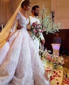 Haute couture long sleeve wedding gowns like this canbe made in a price range youc an afford. We are in the US and offer custom wedding dresses as well as #replicas of couture designs for less. Our version will have the same style and overall look but cost less. Find out how and get pricing when you email us directly. DariusCordell.com