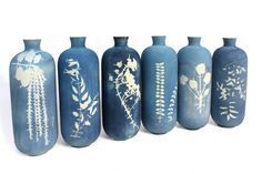 Blueware Vase by Glithero. Blueware is a collection of ceramics with cyanotypes, a process of capturing direct impressions of botanical specimens on earthenware, using photosensitive chemicals.  http://www.themethodcase.com/blueware-vase-by-glithero/