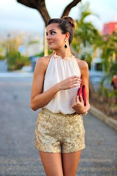 Chiffon halter, gold embroidered shorts, baubles and red clutch