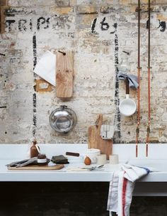 kitchen sink water lines.  Unadorned brick, industrial chic