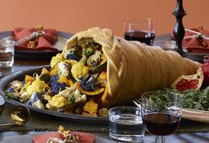 Winter squash, cauliflower, mushrooms, and Brussels sprouts make a colorful roasted vegetable assortment that's enhanced with a little sweetness and spice. (The food stylist used colorful cauliflower varieties and heirloom squash for even richer hues.) Spoon the vegetables into the Holiday Bread Cornucopia or pile on a platter, and serve with the Essence-of-Thanksgiving Gravy.