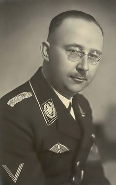 "Heinrich Himmler seen wearing the ribbon to the ""Blood Order"" as prescribed in regulations"