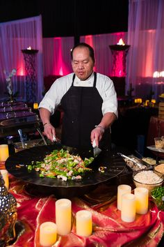 Fire and Ice Event -- March 2013 by LeCroissant Catering and Events. Not only do you get delicious food prepared as you like right in front of you, but you also get a show when you include a Mongolian BBQ action station at your event or party! #lecroissantcatering #eventplanning #uniquepartyideas