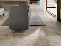 Large stone looking tiles on the interior of a home can give the feel of being outdoors, a very natural and green look. These porcelain tiles resemble venetian stone. Get the look @TILE junket #geelongwest #tiles #interiordesign