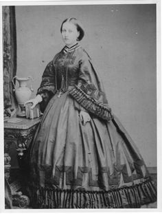 Young Princess Helena wearing a crinoline with pagoda sleeves While the wearer, Princess Helena, is plainly adolescent, this does illustrate high crinoline era day dress. http://www.gogmsite.net/early_victorian_-_1837_-_18/princess_royal_victoria/princesses_helena_and_louis/young_princess_helena_weari.html