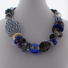 Asymetrical Multi-strand hand-blown Murano Glass bead necklace with Blue and Blue Stripe Beads.