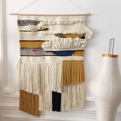 Large wall weaving handmade with natural wool, and organic cotton.70 cm x 106 cm (including the fringes)