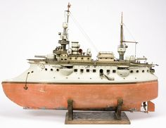 """*HEAVILY ARMORED GUNBOAT ~ """"Andre the Giant""""  is in a keystone in the collection, a masterpiece by M rkllin. What makes it exceptional is that is such an early + pristine example of  its kind. The delicacy of its styling, hand-painteing + detailing would soon give way to the Weissenberg-type ship that lent itself to easier mass-production. But it was toys like this that gave M rklin its worldwide reputation at the best. Est.  $150-250,000"""
