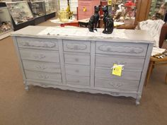 SOLD - 9 drawer dresser painted gray and finished in a tinted wax. Lovely French Provincial styling. Could also be used as a buffet or media cabinet.  ***** In Booth A8 at Main Street Antique Mall 7260 E Main St (east of Power RD on MAIN STREET) Mesa Az 85207 **** Open 7 days a week 10:00AM-5:30PM **** Call for more information 480 924 1122 **** We Accept cash, debit, VISA,