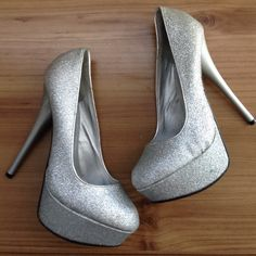 SALESparkly Platform Stilettos A pair of preloved sparkly silver platform stilettos. They are worn but still have a lot of life. All wear and use are in pictures, they're still in good condition other wise. Qupid Shoes Heels