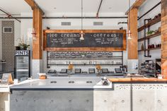 This was a complete new build in recently restored Vancouver building for the latest Earnest Ice Cream manufacturing facility and retail outlet. The design is a mix of fun, playful decorated glass, simple white tiles, concrete, and rustic raw wood and exposed brick. All these elements make for the perfect Vancouver ice cream store.