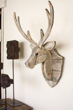 The Recycled Wooden Deer Head Wall Hangingwill give an eye-catching look to your wall. This Deer look natural and have a great finish. The Deer Head Wall Hangin