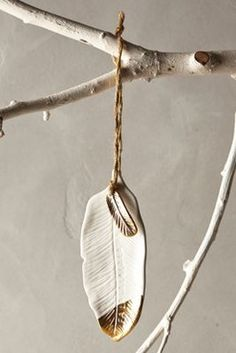 lovely gold dipped feathers