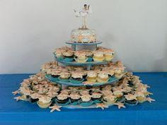 Vanilla, Marble and Chocolate Cupcakes with Ivory Buttercream, Blue Sugar and White Chocolate Starfish.  Cupcake tree.