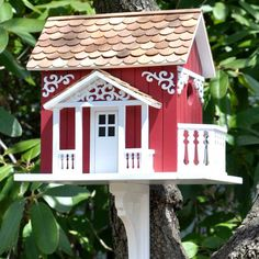 Painted Bird Houses . Swedish designed bird house has both front and side balcony.