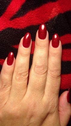 My current nails...natural with acrylic powder overlay and red glitter gel polish...almond shaped. I will get pointier as they grow...I don't want baby-fang, chicklet nails.