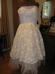 1950's lace and tulle dress with blue tulle flyaways (not showing in this photo) and scattered gray pearls.