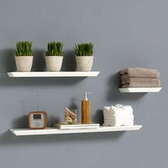 Small Floating Shelf design inspo: floating shelves | jar candle, globe and shelves
